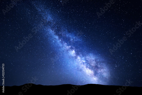 Foto op Canvas Zwart Milky Way. Night colorful landscape with stars. Starry sky with hills at summer. Space background with galaxy at mountains. Nature background with blue milky way. Universe