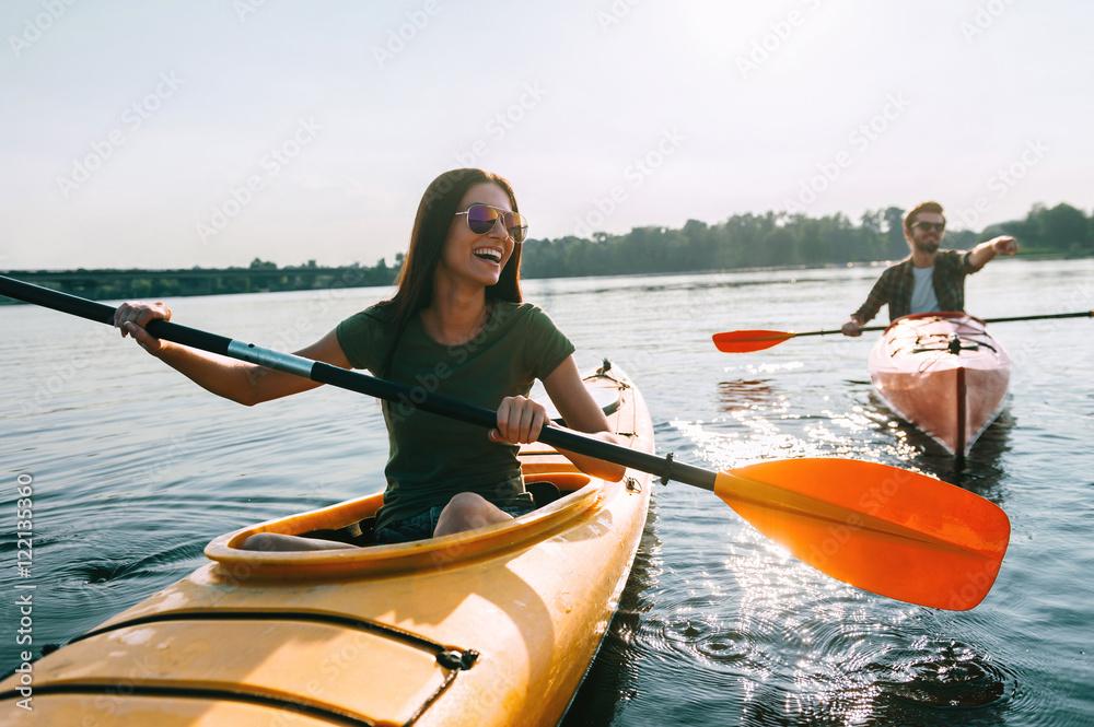 Fototapety, obrazy: Couple kayaking together.