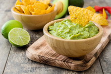 Nachos And Guacamole On Wooden Background