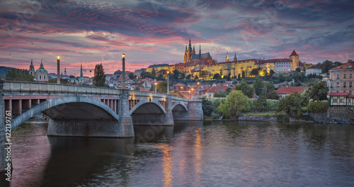 Photo Stands Prague Prague at sunset. Image of Prague, capital city of Czech Republic, during dramatic sunset.