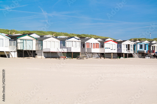 Fotografie, Obraz  Row of beach houses or huts on IJmuiden beach at North Sea coast in Netherlands