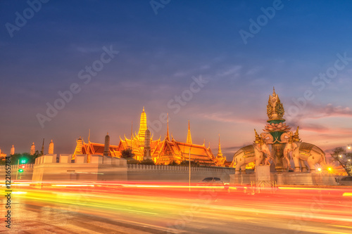 Deurstickers Oranje eclat Light trails on the road and Wat phra keaw, Bangkok Thailand