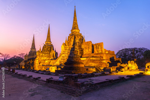 Garden Poster Temple Asian religious architecture. Ancient pagoda at Wat Phra Sri Sanphet temple under twilight sky. Ayutthaya, Thailand
