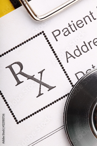 Fotografia  Prescription form in doctor's office macro