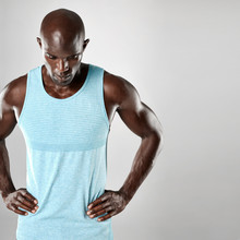 African Man With Bald Head And Muscular Arms