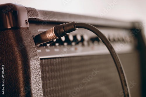 Photo Guitar amplifier with cord plugged in