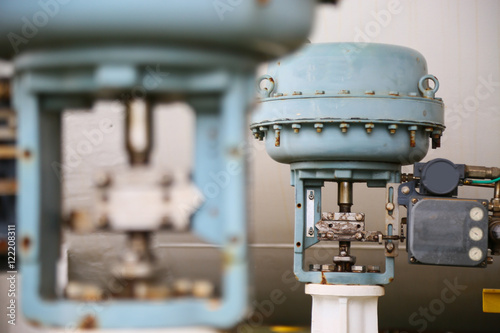 Fotografia, Obraz  Pressure control valve in oil and gas process and controlled by Program Logic Control, PLC controller the valve and control instrument gas supply to actuator of the valve as PLC command
