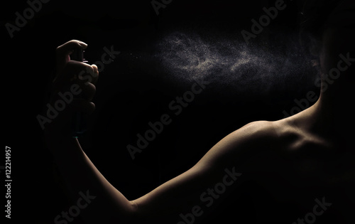 Fototapeta Spraying perfume in woman hand obraz