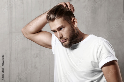 Fotografie, Obraz  Handsome bearded man in a blank white t-shirt with stylish hair