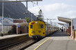 canvas print picture - Railroad station at Fish Hoek western Cape South Africa - April 2016 - A suburban railroad train standing at the platform in Fish Hoek