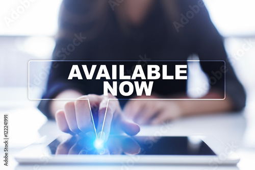 Photo Woman is using tablet pc, pressing on virtual screen and selecting Available now