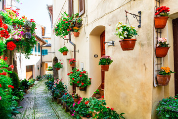 Fototapeta Uliczki Lovely street decoration with flowers - Spello village in Umbria