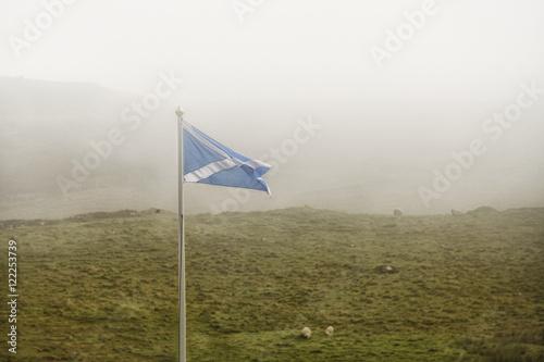 Fotografia, Obraz Scottish flag in the fog