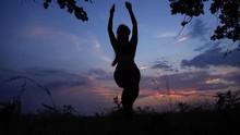 Silhouette Female Girl Do Yoga Against Pink Sunset Sky Tree Pose