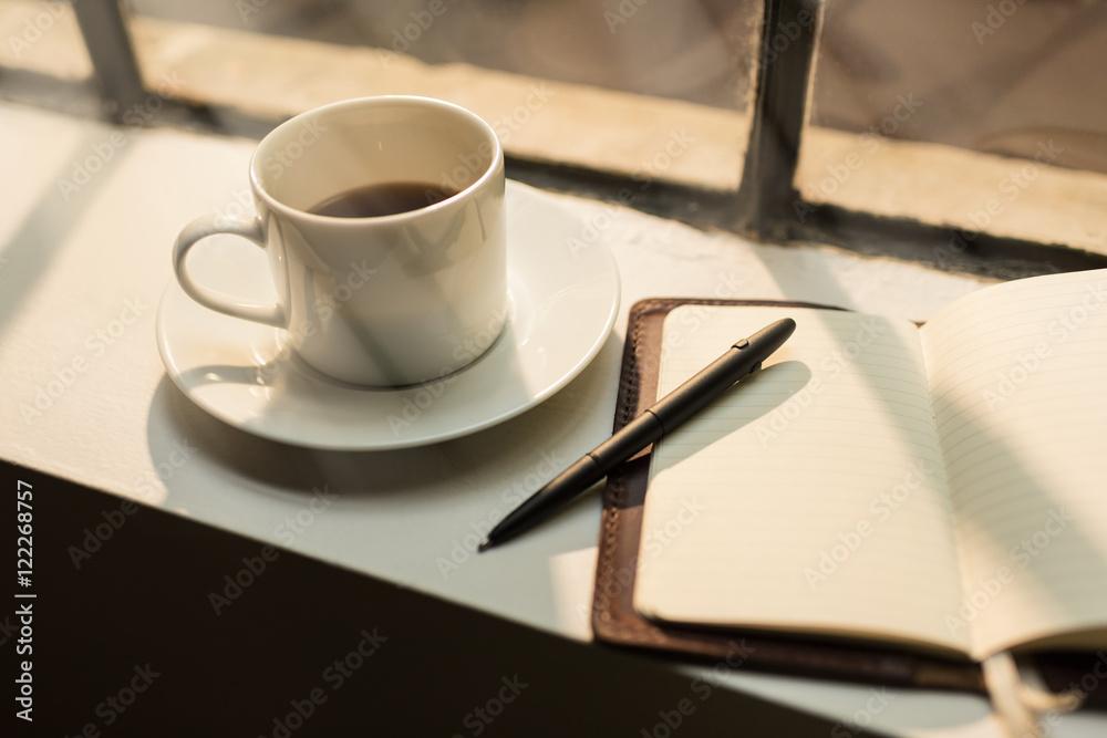 Fototapeta Blank leather journal and coffee