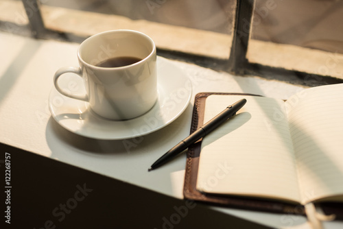 Obraz Blank leather journal and coffee - fototapety do salonu