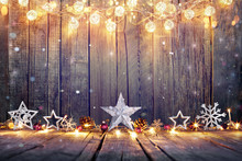 Vintage Christmas Decoration With Stars And Lights On Wooden Table