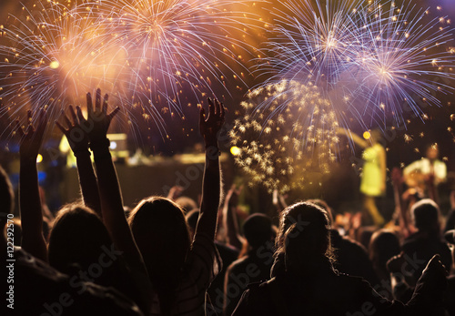 New Year concept - cheering crowd and fireworks #122292570
