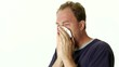 Sick Man Blowing Nose In Tissue