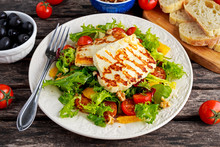 Grilled Halloumi Cheese Salad Witch Orange, Tomatoes And Lettuce. Healthy Food