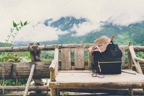 Fotografie, Obraz  Travel backpack on the wooden bench with landscape