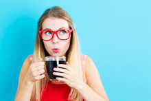Happy Young Woman Drinking Cof...