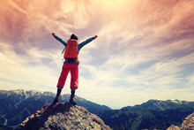 Cheering Young Woman Hiker Open Arms On Mountain Top..