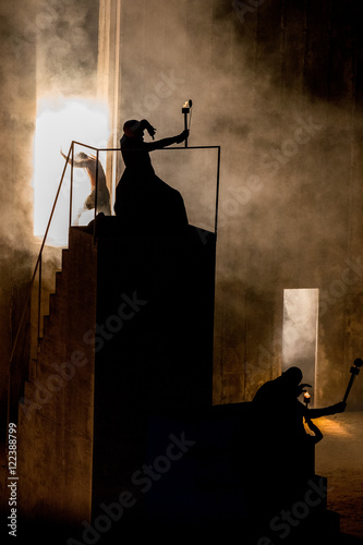 wizard magician silhouette holding a torch Poster