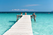 XXX - Wooden Jetty at the Mediterranean Sea with young people in the sun - 4103