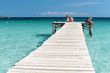 XXX - Wooden Jetty at the Mediterranean Sea with young people in the sun - 4116