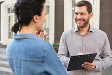 Smiling Woman Meeting With Realtor