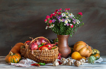 Still Life: Vegetables And A Bouquet Of Flowers. Autumn. Harvest.