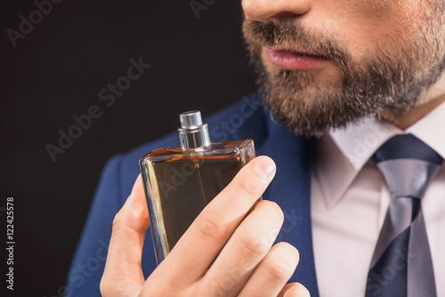 Fototapeta Successful businessman likes perfume scent obraz
