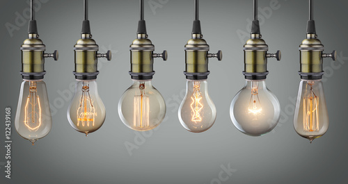 Papiers peints Retro Vintage hanging light bulbs over gray background