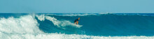 Surfer In Blue Waves In The Ca...