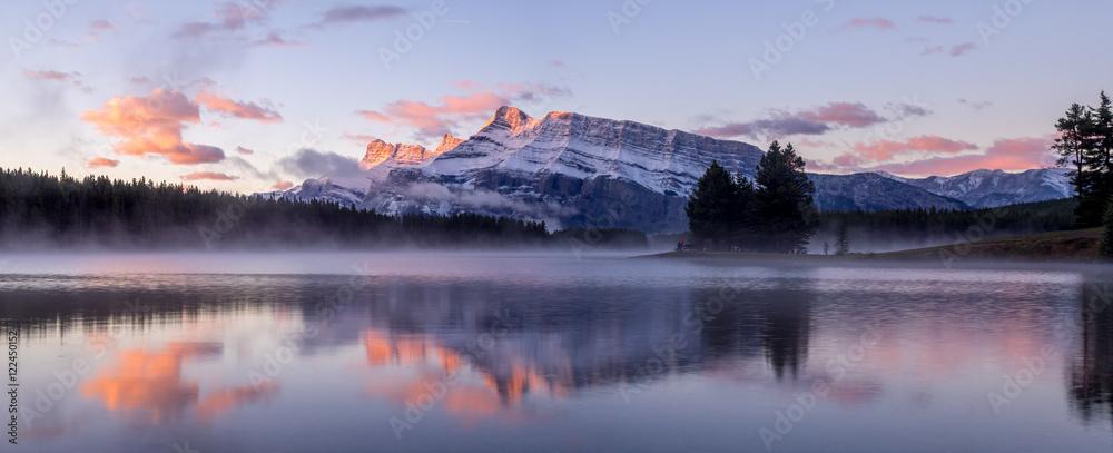 Fototapeta Rundle Mountain reflecting in Two Jack Lake in Banff National Park at sunrise.