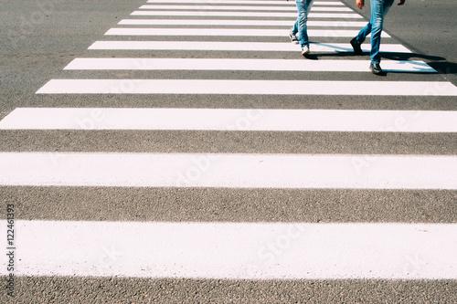 Foto Men running on pedestrian zebra