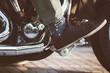 Biker in leather shoe on throttle pedal