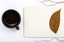 Open Notepad With Autumn Falling Leaves And Cup Of Coffee