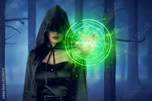 Photo  Asian witch woman with cloak showing green pentagram