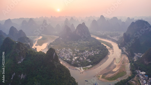 Tuinposter Guilin Breathtaking aerial view over beautiful karst mountain landscape and Li River covered with haze or fog at sunset in Yangshuo County, China