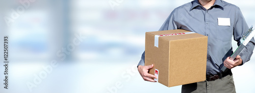 Fotografie, Obraz  Delivery man with a parcel.
