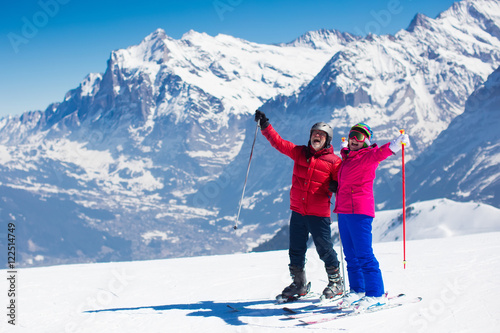 Fotobehang Wintersporten Mature couple skiing in the mountains