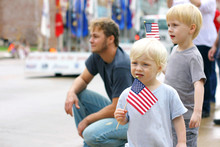 Children Holding American Flag...
