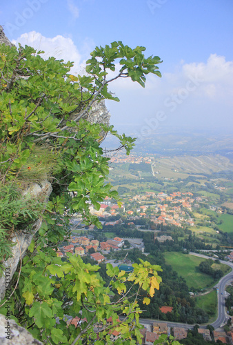 Papiers peints Bleu vert San-Marino / Panoramic view from Mount Titano. Over the cliff on which grow fig trees overlooking the hilly countryside with small towns. This plain extends further to the Adriatic Sea.