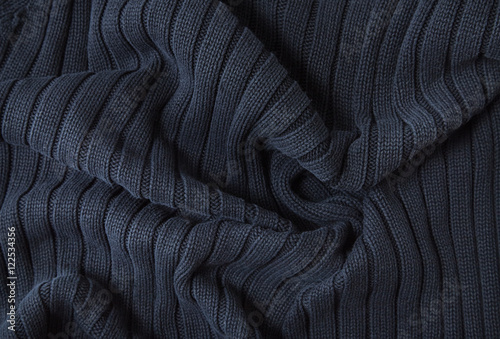 Fotobehang Stof A full page of navy blue knitwear fabric background texture