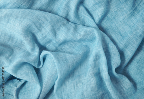 A full page of soft blue linen fabric background texture