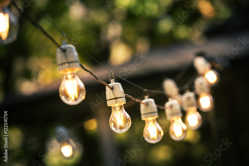 Fotografie, Obraz  outdoor string lights hanging on a line in backyard