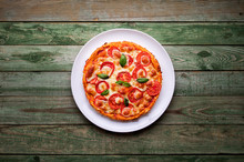 Delicious Pizza With Cheese On White Plate. Pizza On Wood Table