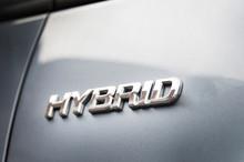 Hybrid Inscription On The Body Of A Modern Car